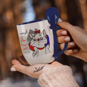 Blue mug with spoon ألووووو