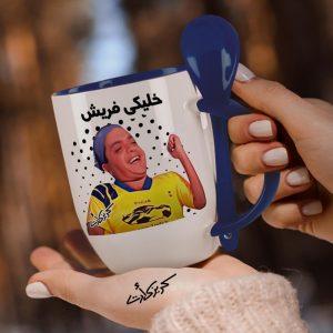 Blue mug with spoon هنيدى خليكى فريش